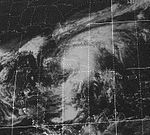 Satellite picture of a broad, sprawling tropical cyclone over the northern Caribbean. The southeastern United States are visible on the northwest corner of the map.