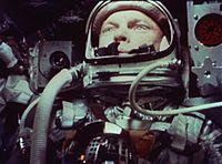 Close-up of John Glenn in space helmet during his flight, 1962