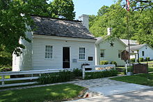 This is a color photo of Grant's birthplace:a small one story wood panel house.