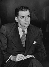 Photo of Hammerstein in middle age, seated, wearing a suit