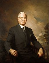 Painting of Caucasian man in dark suit with wire glasses and gray hair