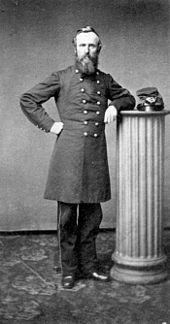 A bearded man in a 19th-century army uniform