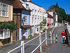 Row of brightly painted cottages