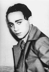 Young man in coat and tie looking to his left
