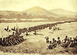 Het zevende bataljon tot de aanval oprukkend.jpg