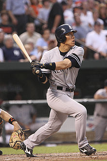 "An Asian male wearing a grey uniform with the lettering ""NEW YORK"" across it, in his after-swing pose"
