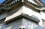 """Photo of two angled chutes or """"stone drop windows"""" on a castle structure"""