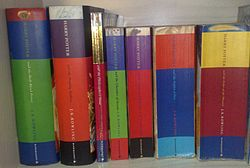 British editions of all seven Harry Potter books, (starting from left) Harry Potter and the Half-Blood Prince, Harry Potter and the Deathly Hallows, Harry Potter and the Philosopher's Stone, Harry Potter and the Chamber of Secrets, Harry Potter and the Prisoner of Azkaban, Harry Potter and the Goblet of Fire, and Harry Potter and the Order of the Phoenix.