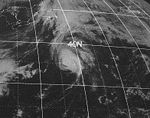 Satellite picture of a fairly tight hurricane over the open Atlantic