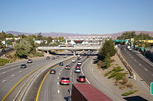 A 6-lane freeway passing under a series of underpasses