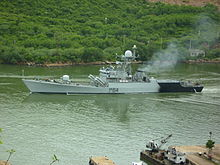 Navy vessel sailing through canal
