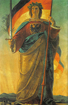 The allegorical figure of Germania (robed woman, sword, flowing hair) is standing, holding sword