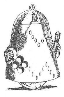 A truncated cone adorned with two encircling rows of small oval markings in a zigzag pattern, topped by a dome and with a large inverted hemisphere for a base. To one side of the cone is attached a device resembling a machine gun and to the other a rod terminating in a group of four spherical objects. Another rod projects from a vertical slot in the front of the dome, terminating in a disc-shaped eyeball.