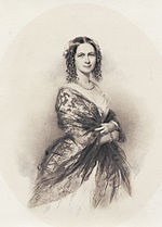 photograph of lady in dress and shawl, pearl necklace, body facing right, smiling face facing viewer