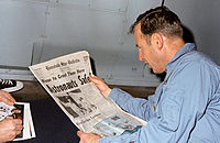 James A. Lovell reads newspaper account of Apollo 13