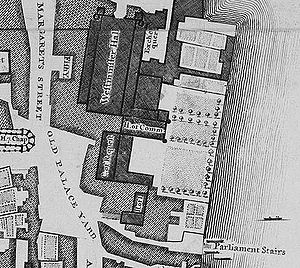 The Old Palace of Westminster was a complex of buildings, separated from the River Thames in the east by a series of gardens. The largest and northernmost building is Westminster Hall, which lies parallel to the river. Several buildings adjoin it on the east side, south of those and perpendicular to the Hall is the mediaeval House of Commons, further south and parallel to the river is the Court of Requests, with an eastwards extension at its south end, and at the south end of the complex lie the House of Lords and another chamber. The Palace was bounded by St Margaret's Street to the west and Old Palace Yard to the south-west; another street, New Palace Yard, is just visible to the north.