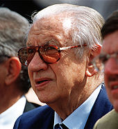 a head shot of Juan Antonio Samaranch with dark glasses on