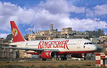"Airport terminal with airplane labeled ""Kingfisher"""