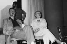 A man and a woman sitting on chairs