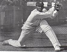 A cricketer batting