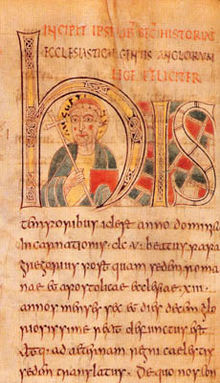 Illuminated manuscript with a forward facing man in the middle of the large H. Man is carrying a crozier and his head is surrounded by a halo