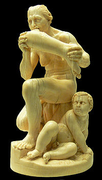 Marble statue of naked woman eating a human leg with a child watching at her feet