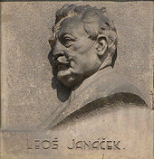 wall plaque with profile of a man's head; he is elderly with a moustache and a full head of hair
