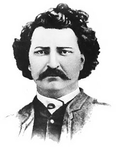 """Black and white bust shot of Louis Riel, after a carte de visite from 1884."""
