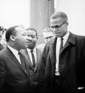 Martin Luther King, Jr. (left) speaking with Malcolm X