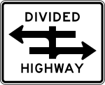 A divided highway sign. Two parallel arrows, pointing in opposite directions are crossed by a vertical line.