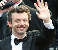 Close-up of Sheen outdoors, smiling and waving
