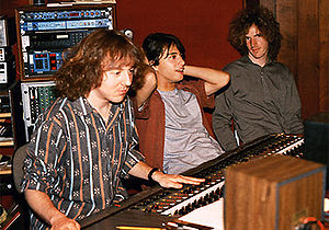Mitch Easter sitting at a mixing board next to two members of Dreams So Real