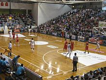 A basketball game being played in a stadium