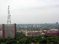 Distant photo of building complex with tower