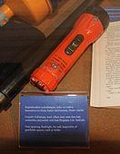 Orange plastic tubular flashlight with side switch