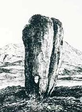 A black and white line drawing of a tall standing stone that is wider at the top than the base. It has a long vertical crack on the right hand side and there is a small hole that goes right through it near the ground. A lake and hill are in the background.