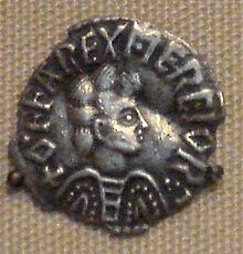 Coin with a man in profile surrounded by lettering reading OFFAREXMERCIOR