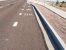 Pavement markings indicate sidewalk riding is legal.