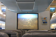 A television screen with the view of the city from the aircraft's nose camera