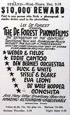 "All-text advertisement from the Strand Theater, giving dates, times, and performers&squot; names. At the top, a tagline reads, ""$10,000 reward paid to any person who finds a phonograph or similar device used in the phonofilms."" The accompanying promotional text describes the slate of sound pictures as ""the sensation of the century ... Amazing! Astounding! Unbelievable""."