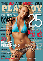 Cover shot of a svelte, young, blond woman wearing a bikini and looking intently into the camera.