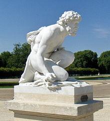 Statue de Pluton (vers 1884-1886) par Henri Chapu, située dans le parc du château de Chantilly.