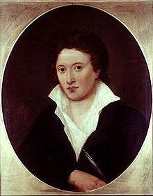 Portrait en buste, d'un homme portant une veste noire et une chemise blanche de travers et ouverte sur sa poitrine.