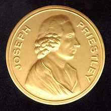 """Photograph of a gold medal, which says """"Joseph Priestley"""" around the edge and has a profile of a man stamped in the center"""