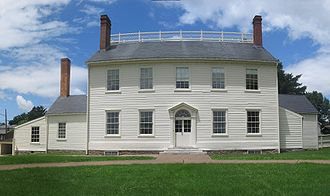 Photograph of a two-story, white clapboard house