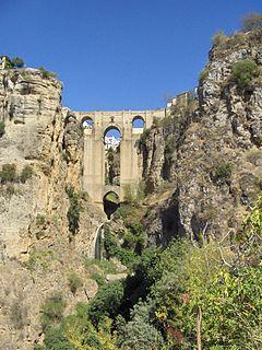 The 1793 Puente Nuevo bridge allows viewing from 120 m above the floor of El Tajo canyon.
