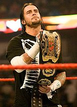 Punk como Campeón Mundial en Parejas en 2008.