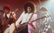John Deacon, Brian May, Freddie Mercury en directo (1978).