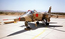 Jet aircraft in desert camouflage scheme taxiing.