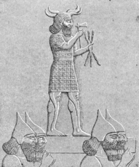 Assyrian soldiers carrying a statue of Adad